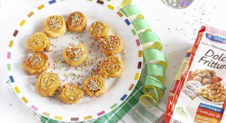 Girelle di Carnevale con arancia candita e cardamomo